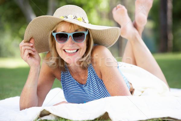 Idős nő megnyugtató nyár kert fű Stock fotó © monkey_business