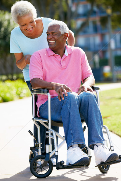 Senior Woman Pushing Husband In Wheelchair Stock photo © monkey_business