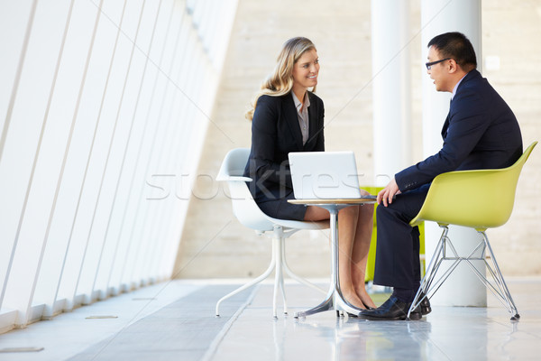 Businessman And Businesswoman Meeting In Modern Office Stock photo © monkey_business