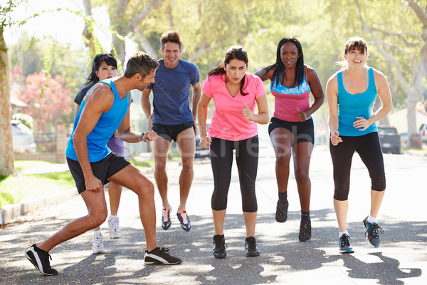 Group Of People Exercising Street With Personal Trainer Stock photo © monkey_business