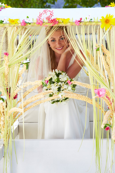 Bride Sitting Under Decorated Canopy At Wedding Stock photo © monkey_business