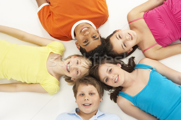 Overhead View Of Five Young Children In Studio Stock photo © monkey_business