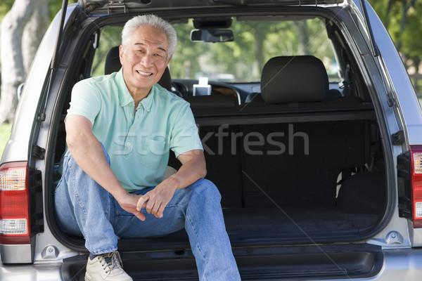 Man sitting in back of van smiling Stock photo © monkey_business