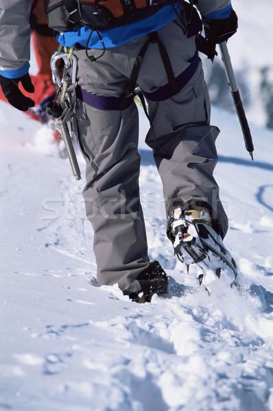 Giovane alpinismo uomo neve montagna Foto d'archivio © monkey_business