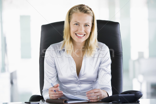 Businesswoman in office with personal organizer smiling Stock photo © monkey_business