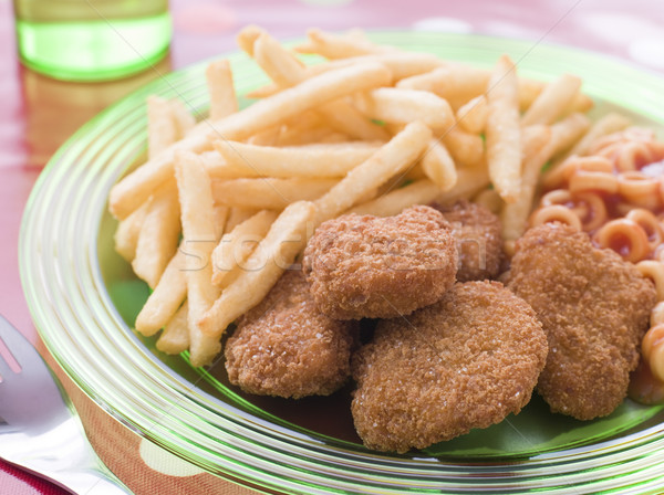 Chicken Nuggets with Spaghetti Hoops and Chips Stock photo © monkey_business