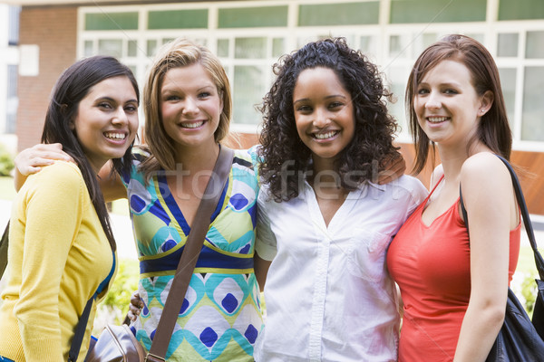 Female college friends on campus Stock photo © monkey_business