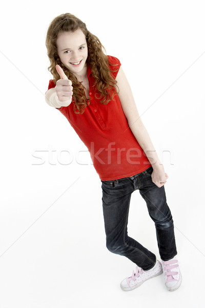 Full Length Portrait Of Young Girl Giving Thumbs Up Stock photo © monkey_business