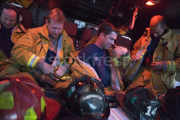 Strażacy awaryjne mężczyzn kask kolor Zdjęcia stock © monkey_business