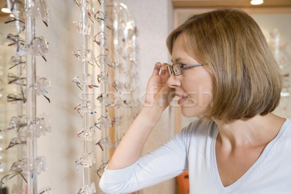 Woman trying on eyeglasses at optometrists Stock photo © monkey_business