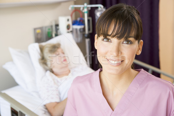 Nurse Standing In Hospital Room,Smiling Stock photo © monkey_business
