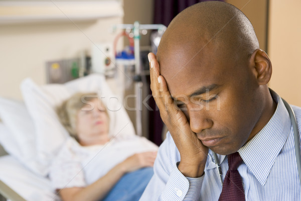 Doctor Looking Tired And Frustrated In Hospital Room Stock photo © monkey_business
