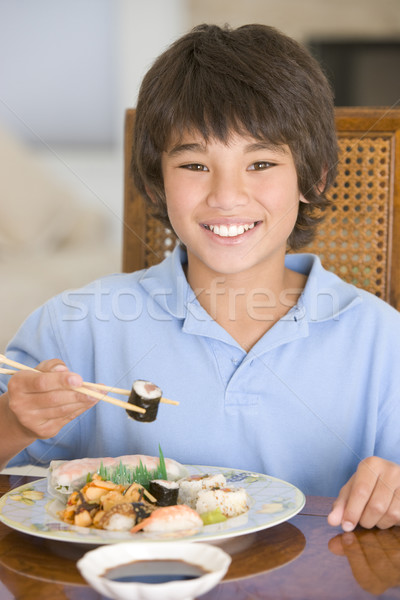 Young boy in dining room eating chinese food smiling Stock photo © monkey_business
