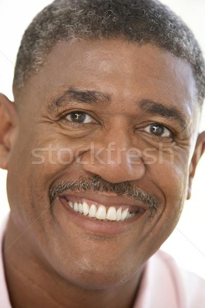 Portré középkorú férfi mosolyog kamera boldog személy Stock fotó © monkey_business