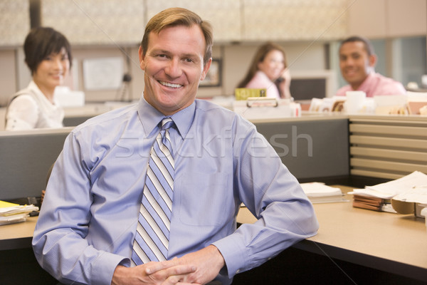 Businessman in cubicle smiling Stock photo © monkey_business