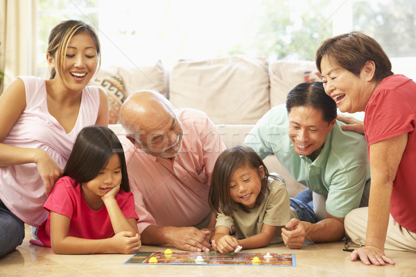Extended Family Group Playing Board Game At Home Stock photo © monkey_business
