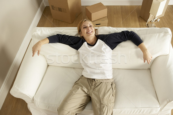 Stock photo: Overhead View Of Young Woman Moving Into New Home