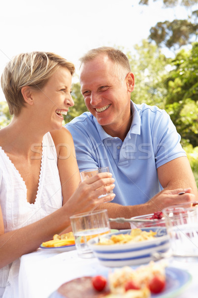 Сток-фото: пару · еды · саду · женщину · счастливым