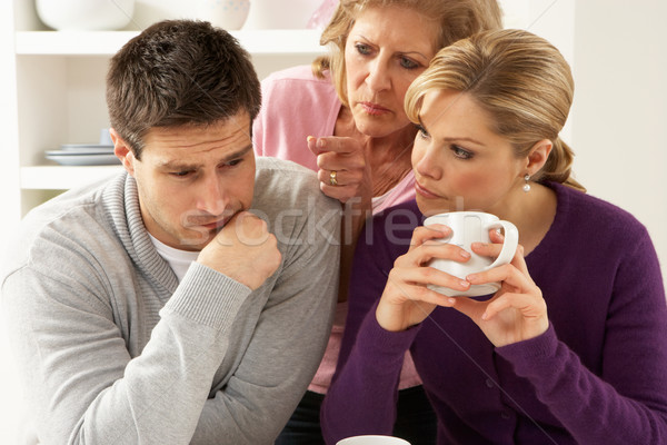 Senior Mother Interferring With Couple Having Argument At Home Stock photo © monkey_business