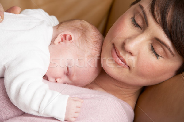 Portrait Of Mother Resting With Newborn Baby At Home Stock photo © monkey_business