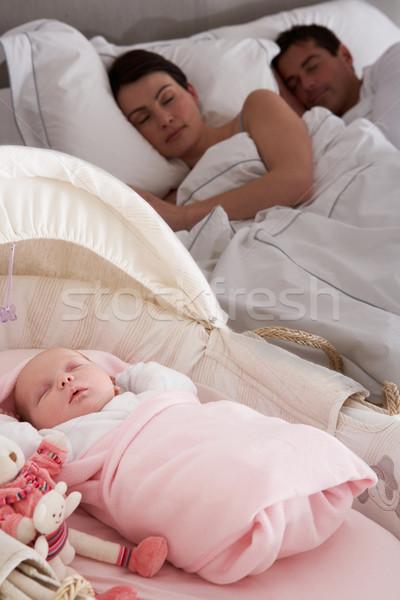 Newborn Baby Sleeping In Cot In Parents Bedroom Stock photo © monkey_business