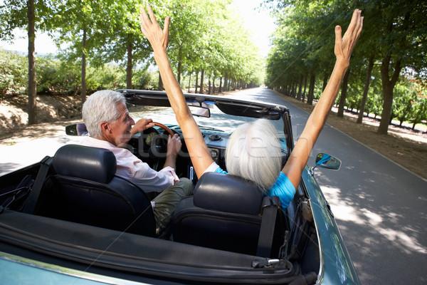 Idős pár sportautó autó út nap sportok Stock fotó © monkey_business