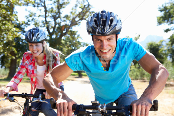 Young couple on country bike ride Stock photo © monkey_business