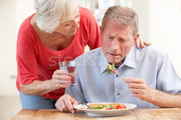 Idős nő néz beteg férj üveg Stock fotó © monkey_business