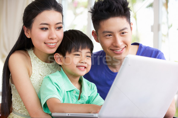 Chinese Family Sitting At Desk Using Laptop At Home Stock photo © monkey_business