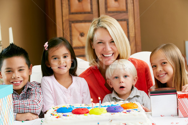 Mother Celebrating Child's Birthday With Friends Stock photo © monkey_business