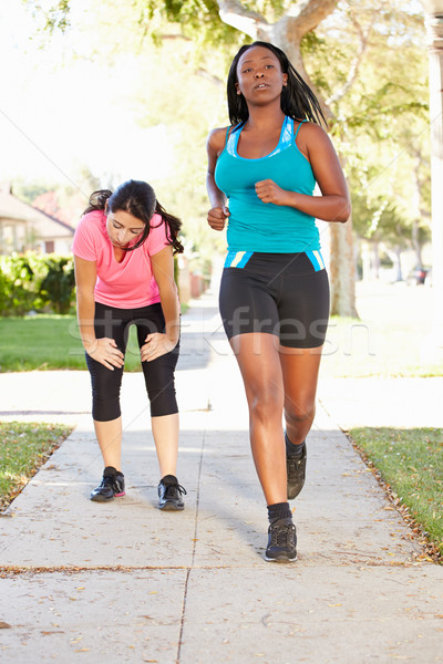 Two Female Runners Exercising On Suburban Street Stock photo © monkey_business