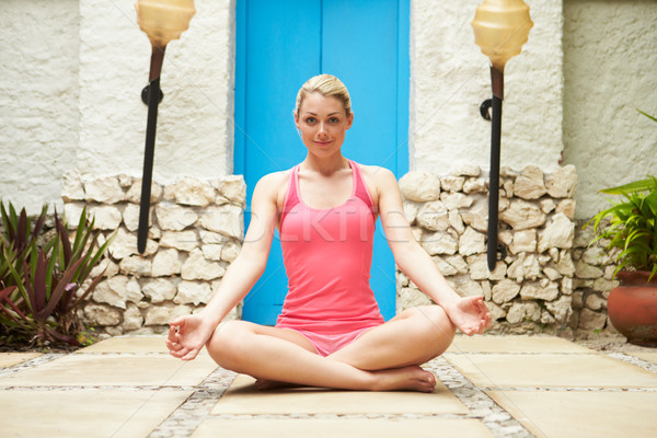 Woman Meditating Outdoors At Health Spa Stock photo © monkey_business