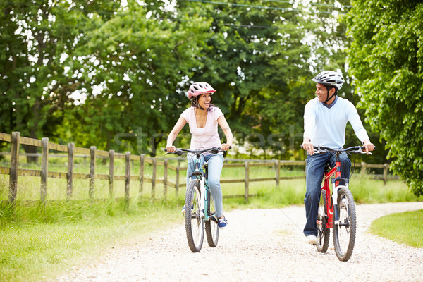 Indian Couple On Cycle Ride In Countryside Stock photo © monkey_business