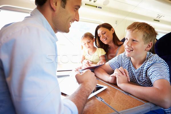 семьи расслабляющая поезд путешествия компьютер девушки Сток-фото © monkey_business