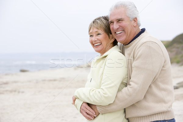 Couple at the beach embracing and smiling Stock photo © monkey_business