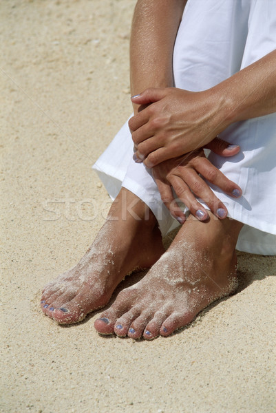 Young woman's feet covered in sand Stock photo © monkey_business