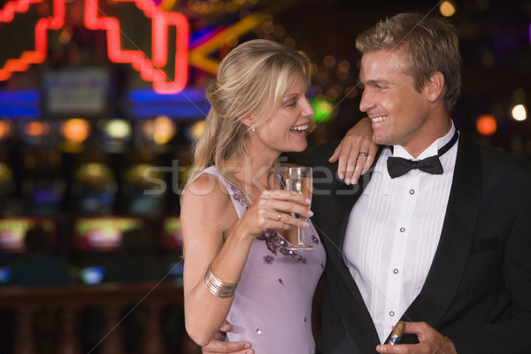 Couple celebrating in casino Stock photo © monkey_business