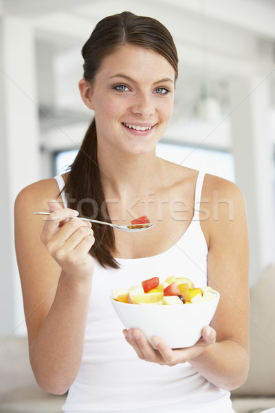 Young Woman Eating Fresh Fruit Salad Stock photo © monkey_business