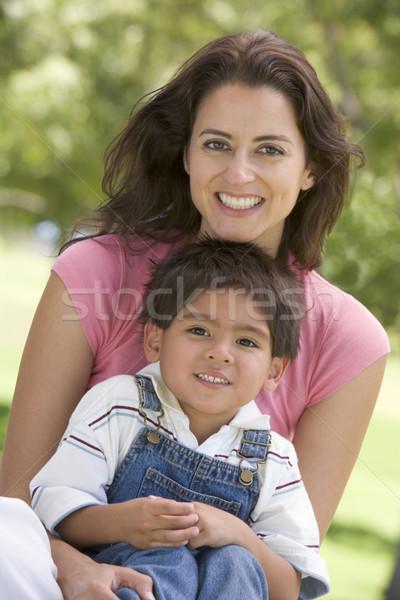 Femme séance extérieur femme souriante souriant Photo stock © monkey_business
