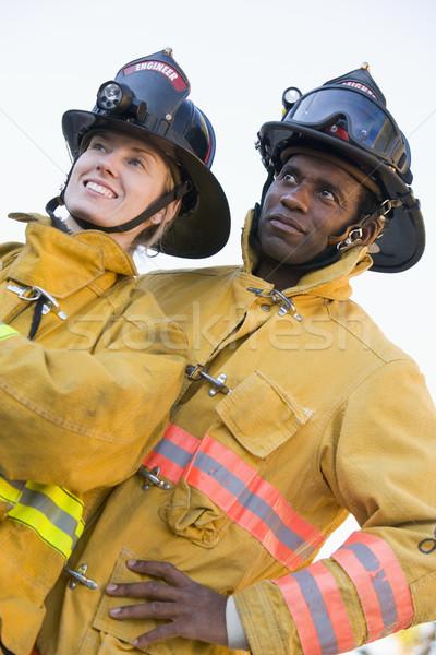 Portré tűzoltók nő férfi női mosolyog Stock fotó © monkey_business