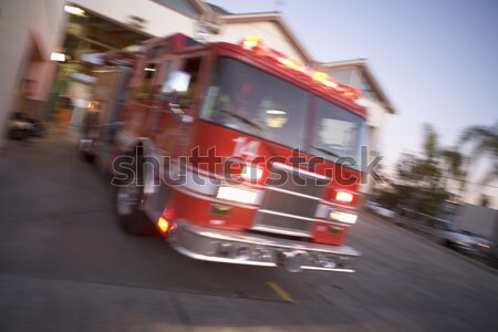 Fire engine driving down street Stock photo © monkey_business