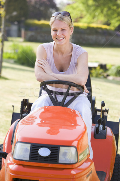 Woman outdoors with lawnmower smiling Stock photo © monkey_business