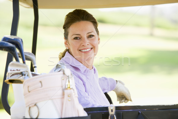 Portrait Of Woman Sitting In A Golf Cart Stock photo © monkey_business