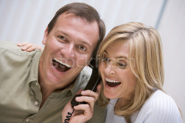 Couple receiving good news over the phone Stock photo © monkey_business