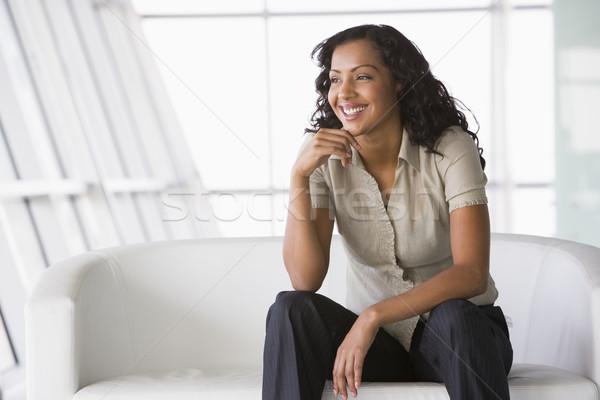 Imprenditrice seduta divano ufficio città Foto d'archivio © monkey_business