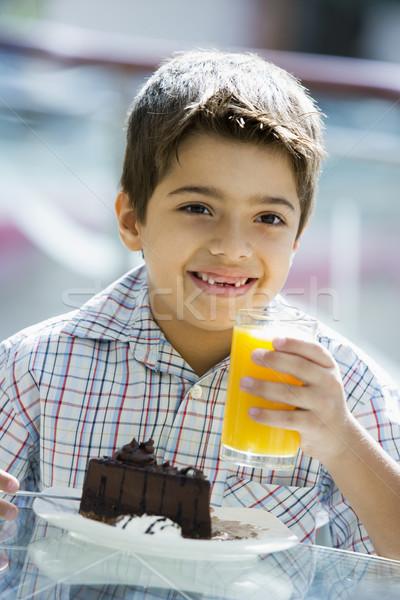 Boy drinking orange juice in cafe Stock photo © monkey_business