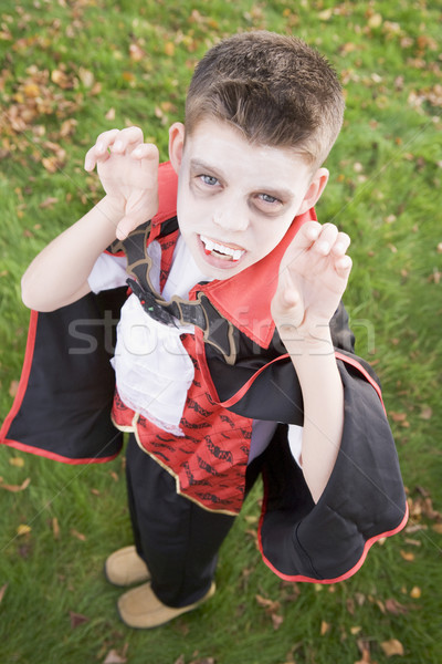 Young boy outdoors wearing vampire costume on Halloween Stock photo © monkey_business