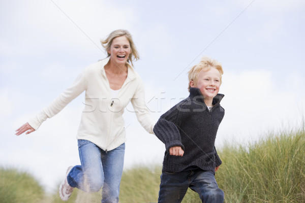 Stock photo: Mother and son running on beach smiling