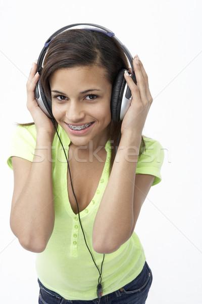 Retrato sonriendo escuchar música mujer nina Foto stock © monkey_business