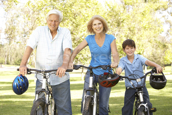 Grandparents And Grandson On Cycle Ride In Park Stock photo © monkey_business